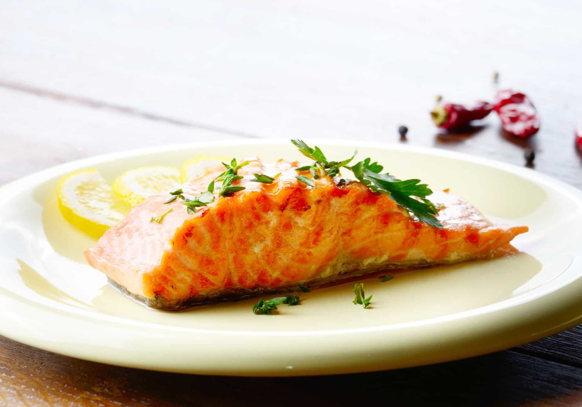 fried salmon fish filet with lemon and parsley
