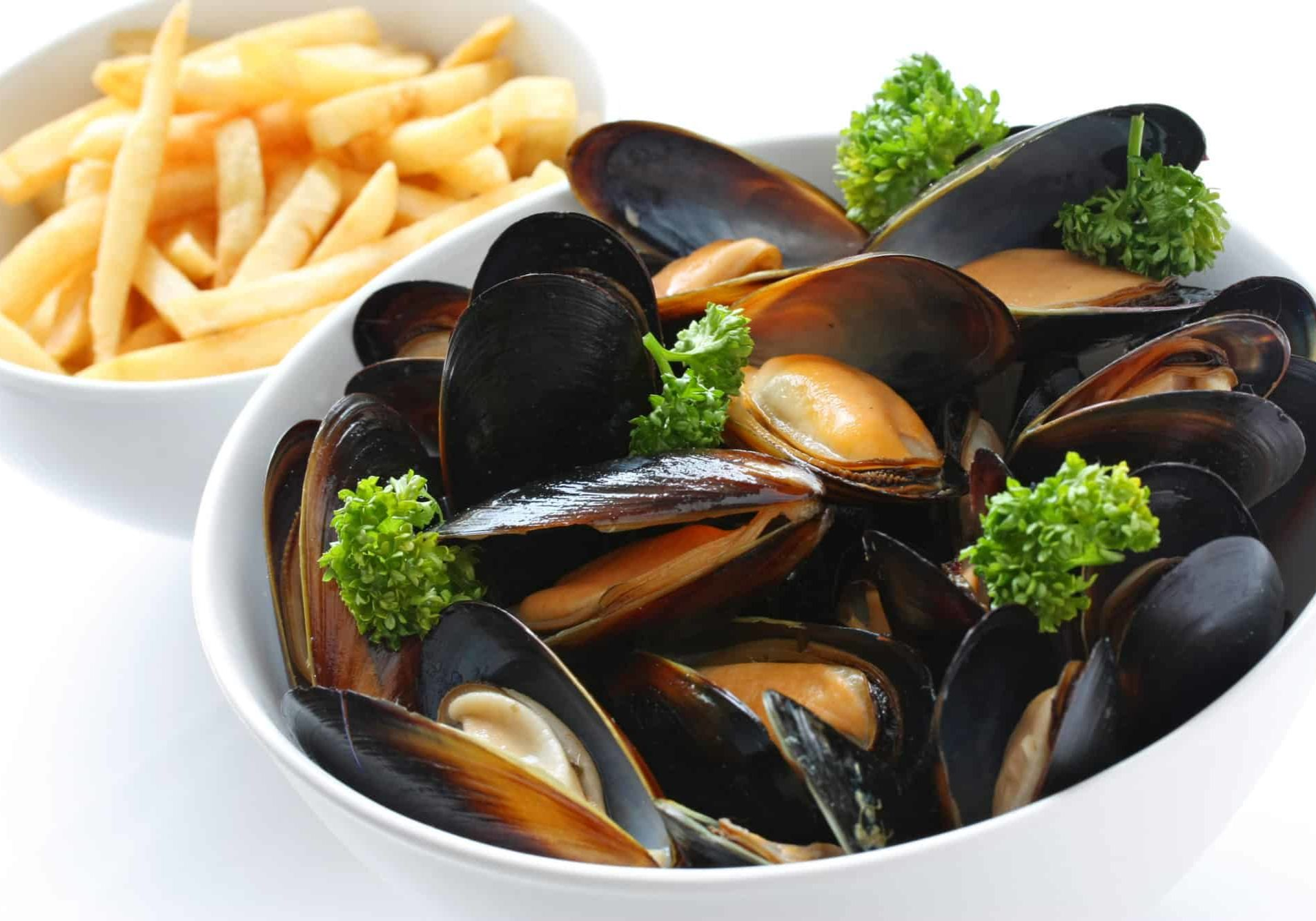 fresh steamed mussels seafood dish with french fries